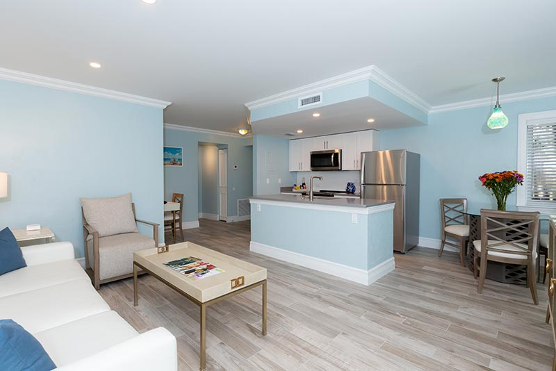 Deluxe One Bedroom open floor plan with full-size kitchen and living room.