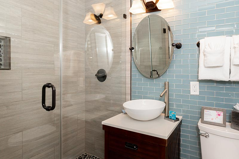 Deluxe One Bedroom Suite Bathroom with Sink and Shower.