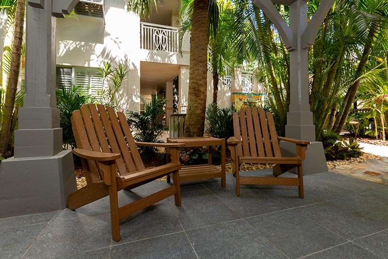 Deluxe One Bedroom Suite patio with two chairs.
